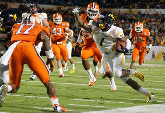 MIAMI GARDENS, FL - JANUARY 04:  Tavon Austin #1 of the West Virginia Mountaineers  scores a27-yard touchdown reception in the second quarter against the Clemson Tigers during the Discover Orange Bowl at Sun Life Stadium on January 4, 2012 in Miami Garden