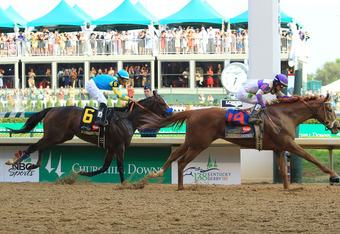 LOUISVILLE, KY - MAY 05:  Mario Gutierrez celebrates atop I'll Have Another after winning the 138th running of the Kentucky Derby ahead of Bodemeister ridden by Mike Smith at Churchill Downs on May 5, 2012 in Louisville, Kentucky.  (Photo by Travis Lindqu