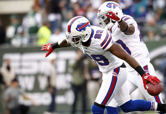EAST RUTHERFORD, NJ - NOVEMBER 27:  Drayton Florence #29 and Aaron Williams #23 of the Buffalo Bills celebrate an interception against the New York Jets  during their game at MetLife Stadium on November 27, 2011 in East Rutherford, New Jersey.  (Photo by