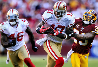 LANDOVER, MD - NOVEMBER 6: Wide receiver Braylon Edwards #17 of the San Francisco 49ers eludes cornerback DeAngelo Hall #23 of the Washington Redskins during the third quarter at FedExField on November 6, 2011 in Landover, Maryland. The San Francisco 49er
