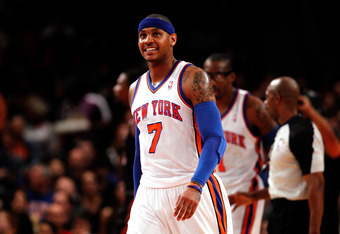 NEW YORK, NY - MAY 06:  Carmelo Anthony #7 of the New York Knicks looks on against the Miami Heat in Game Four of the Eastern Conference Quarterfinals in the 2012 NBA Playoffs on May 6, 2012 at Madison Square Garden in New York City. NOTE TO USER: User ex