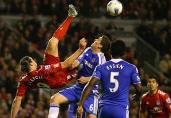 LIVERPOOL, ENGLAND - MAY 08:  Andy Carroll of Liverpool attempts an over head kick during the Barclays Premier League match between Liverpool and Chelsea at Anfield on May 8, 2012 in Liverpool, England.  (Photo by Alex Livesey/Getty Images)