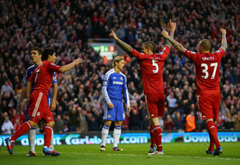 LIVERPOOL, ENGLAND - MAY 08: Daniel Agger of Liverpool celebrates scoring their third goal with Luis Suarez and Martin Skrtel of Liverpool during the Barclays Premier League match between Liverpool and Chelsea at Anfield on May 8, 2012 in Liverpool, Engla
