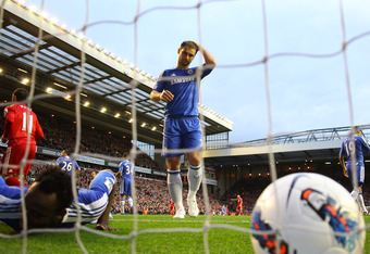LIVERPOOL, ENGLAND - MAY 08: Branislav Ivanovic of Chelsea puts his hand on his head after Michael Essien of Chelsea (L) scores an own goal during the Barclays Premier League match between Liverpool and Chelsea at Anfield on May 8, 2012 in Liverpool, Engl