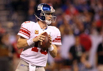 INDIANAPOLIS, IN - FEBRUARY 05:  Quarterback Eli Manning #10 of the New York Giants looks to pass the ball while taking on the New England Patriots during Super Bowl XLVI at Lucas Oil Stadium on February 5, 2012 in Indianapolis, Indiana.  (Photo by Ezra S