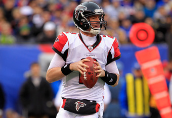 EAST RUTHERFORD, NJ - JANUARY 08:  Matt Ryan #2 of the Atlanta Falcons rolls out of the pocket as he looks to pass against the New York Giants during their NFC Wild Card Playoff game at MetLife Stadium on January 8, 2012 in East Rutherford, New Jersey.  (