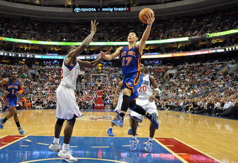 PHILADELPHIA, PA - MARCH 21: Jeremy Lin #17 of the New York Knicks lays up a shot over Elton Brand #42 of the Philadelphia 76ers at the Wells Fargo Center on March 21, 2012 in Philadelphia, Pennsylvania. The Knicks won 82-79. NOTE TO USER: User expressly