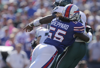 ORCHARD PARK, NY - OCTOBER 09:  Kelvin Sheppard #55 of the Buffalo Bills just misses sacking Michael Vick #7 of the Philadelphia Eagles in the second half at Ralph Wilson Stadium on October 9, 2011 in Orchard Park, New York.  (Photo by Brody Wheeler/Getty