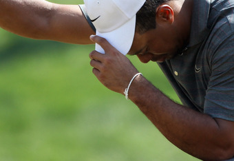 ABU DHABI, UNITED ARAB EMIRATES - JANUARY 28:  Tiger Woods of the USA looks dejected during the third round of The Abu Dhabi HSBC Golf Championship at Abu Dhabi Golf Club on January 28, 2012 in Abu Dhabi, United Arab Emirates.  (Photo by Andrew Redington/