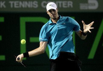 KEY BISCAYNE, FL - MARCH 25:  John Isner returns a shot to Florian Mayer of Germany during the Sony Ericsson Open at the Crandon Park Tennis Center on March 25, 2012 in Key Biscayne, Florida.  (Photo by Matthew Stockman/Getty Images)