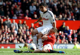 MANCHESTER, ENGLAND - MAY 06:  Neil Taylor of Swansea City tangles with Tom Cleverley of Manchester United during the Barclays Premier League match between Manchester United and Swansea City at Old Trafford on 6 May 2012 in Manchester, England.  (Photo by