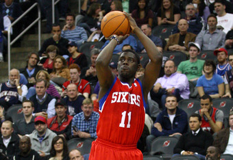 NEWARK, NJ - APRIL 23:  Jrue Holiday #11 of the Philadelphia 76ers attempts a shot against the New Jersey Nets at Prudential Center on April 23, 2012 in Newark, New Jersey. Tonight's game is the last home game the Nets will play in New Jersey since the fr