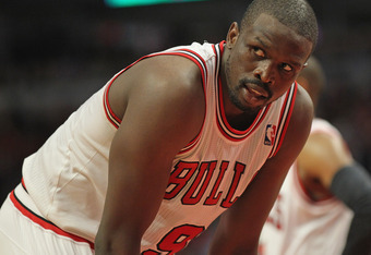 CHICAGO, IL - MAY 08: Loul Deng #9 of the Chicago Bulls shoots a look at a referee after being knocked down against the Philadelphia 76ers in Game Five of the Eastern Conference Quarterfinals during the 2012 NBA Playoffs at the United Center on May 8, 201