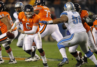 CHICAGO, IL - NOVEMBER 13: Jay Cutler #6 of the Chicago Bears is flushed out of the pocket by Ndamukong Suh #90 of the Detroit Lions at Soldier Field on November 13, 2011 in Chicago, Illinois. (Photo by Jonathan Daniel/Getty Images)