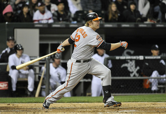 CHICAGO, IL - APRIL 16:   Mark Reynolds #12 of the Baltimore Orioles follows through on an RBI double scoring teammate Adam Jones #10 during the fourth inning against the Chicago White Sox at U.S. Cellular Field on April 16, 2012 in Chicago, Illinois.  (P