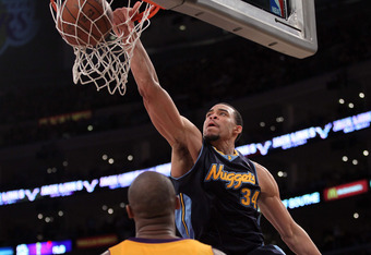 LOS ANGELES, CA - MAY 08:  JaVale McGee #34 of the Denver Nuggets dunks the ball as Kobe Bryant #24 of the Los Angeles Lakers looks on in the second half in Game Five of the Western Conference Quarterfinals in the 2012 NBA Playoffs on May 8, 2012 at Stapl