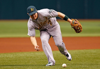 ST. PETERSBURG, FL - MAY 05:  Infielder Brandon Inge #7 of the Oakland Athletics fields a ground ball against the Tampa Bay Rays during the game at Tropicana Field on May 5, 2012 in St. Petersburg, Florida.  (Photo by J. Meric/Getty Images)