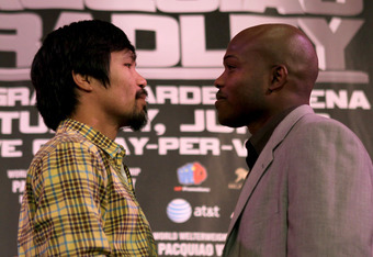 BEVERLY HILLS, CA - FEBRUARY 21:  Manny Pacquiao (L) and Timothy Bradley pose for photographers at a press conference announcing their upcoming World Boxing Organization welterweight championship fight at The Beverly Hills Hotel on February 21, 2012 in Be