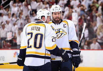 GLENDALE, AZ - MAY 07:  (L-R) Ryan Suter #20 and Shea Weber #6 of the Nashville Predators talk during a break from Game Five of the Western Conference Semifinals against the Phoenix Coyotes during the 2012 NHL Stanley Cup Playoffs at Jobing.com Arena on M