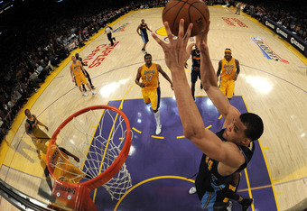 LOS ANGELES, CA - MAY 01:  JaVale McGee #34 of the Denver Nuggets gets ready to dunk on the Los Angeles Lakers during a 104-100 Laker win in Game Two of the Western Conference Quarterfinals in the 2012 NBA Playoffs at Staples Center on May 1, 2012 in Los