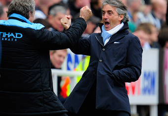 NEWCASTLE UPON TYNE, ENGLAND - MAY 06:  Manchester City manager Roberto Mancini (c) celebrates the 2nd goal during the Barclays Premier league match between Newcastle United and Manchester City at Sports Direct Arena on May 6, 2012 in Newcastle upon Tyne,