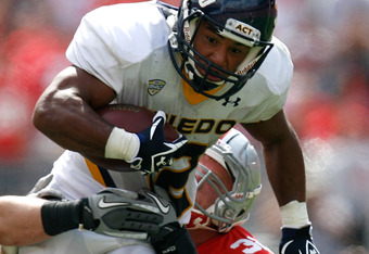 COLUMBUS, OH - SEPTEMBER 10:  Eric Page #12 of the Toledo Rockets is tackled by Storm Klein #32 of the Ohio State Buckeyes during the third quarter on September 10, 2011 at Ohio Stadium in Columbus, Ohio. Ohio State defeated Toledo 27-22. (Photo by Kirk I