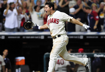 CLEVELAND, OH - JULY 30: Matt LaPorta #7 of the Cleveland Indians celebrates as he arrives at home plate after hitting a walk-off three run home run to defeat the Royals 5-2 at Progressive Field on July 30, 2011 in Cleveland, Ohio. (Photo by Jason Miller/