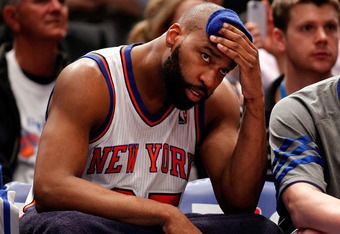 NEW YORK, NY - MAY 03:  Baron Davis #85 of the New York Knicks looks on dejected from the bench in the fourth quarter against the Miami Heat in Game Three of the Eastern Conference Quarterfinals in the 2012 NBA Playoffs on May 3, 2012 at Madison Square Ga