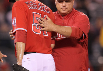 ANAHEIM, CA - APRIL 18:  Manager Mike Scioscia of the Los Angeles Angels of Anaheim relieves pitcher Jordan Walden #51 in the ninth inning against the Oakland Athletics at Angel Stadium of Anaheim on April 18, 2012 in Anaheim, California.  Oakland won 6-0