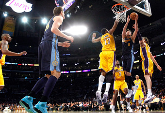 LOS ANGELES, CA - MAY 08:  Danilo Gallinari #8 of the Denver Nuggets goes up for a shot against Andrew Bynum #17 and Pau Gasol #16 of the Los Angeles Lakers in the second half in Game Five of the Western Conference Quarterfinals in the 2012 NBA Playoffs o