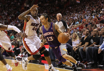 MIAMI - NOVEMBER 17:  Steve Nash #13  of the Phoenix Suns dribbles around Udonis Haslem #40 during a game against the  Miami Heat at American Airlines Arena on November 17, 2010 in Miami, Florida. NOTE TO USER: User expressly acknowledges and agrees that,