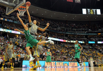 DENVER, CO - APRIL 03:  Brittney Griner #42 of the Baylor Bears blocks a shot attempt in the seocnd half by Kayla McBride #23 of the Notre Dame Fighting Irish during the National Final game of the 2012 NCAA Division I Women's Basketball Championship at Pe