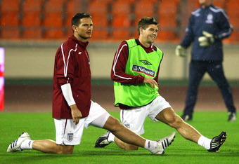MINSK, BELARUS - OCTOBER 14:  Frank Lampard and Steven Gerrard of England stretch during a training session held at the Dinamo Stadium on October 14, 2008 in Minsk, Belarus.  (Photo by Alex Livesey/Getty Images)