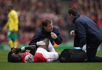 LONDON, ENGLAND - MAY 05:  Medical staff attend to Bacary Sagna of Arsenal as he lies injured on the pitch during the Barclays Premier League match between Arsenal and Norwich City at the Emirates Stadium on May 5, 2012 in London, England.  (Photo by Bryn