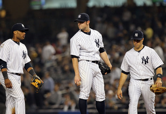 NEW YORK, NY - MAY 09:  David Robertson #30 of the New York Yankees reacts after giving up a 3 RBI home run to Matt Joyce #20 of the Tampa Bay Rays at Yankee Stadium on May 9, 2012 in the Bronx borough of New York City.  (Photo by Nick Laham/Getty Images)