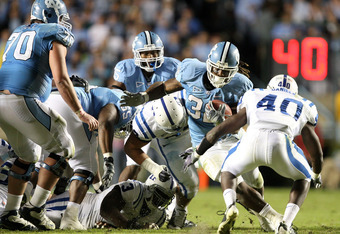 CHAPEL HILL, NC - NOVEMBER 07:  Matt Daniels #40 of the Duke Blue Devils tries to tackle Ryan Houston #32 of the North Carolina Tar Heels during their game at Kenan Stadium on November 7, 2009 in Chapel Hill, North Carolina.  (Photo by Streeter Lecka/Gett