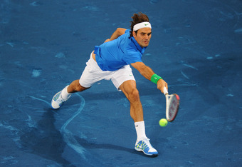MADRID, SPAIN - MAY 09:  Roger Federer of Switzerland in action during his 3rd round match with Milos Raonic of Canada in the Mutua Madrilena Madrid Open at the Caja Magica on May 9, 2012 in Madrid, Spain.  (Photo by Mike Hewitt/Getty Images)