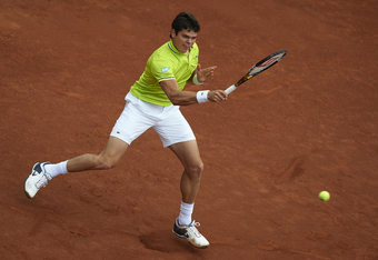 BARCELONA, SPAIN - APRIL 27:  Milos Raonic of Canada returns a ball to Andy Murray of Great Britain during their match on day 5 of the ATP 500 World Tour Barcelona Open Banco Sabadell 2012 tennis tournament at the Real Club de Tenis on April 27, 2012 in B