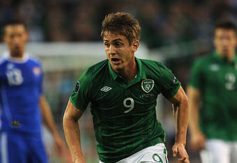Perfect Partner: Kevin Doyle can mix it with Robbie Keane, Walters or Long in the Irish attack.