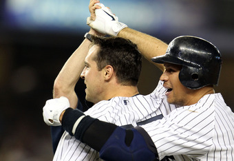 NEW YORK, NY - MAY 24:  Mark Teixeira #25 of the New York Yankees celebrates with Alex Rodriguez #13 after hitting a game winning RBI in the ninth inning against the Toronto Blue Jays at Yankee Stadium on May 24, 2011 in the Bronx borough of New York City