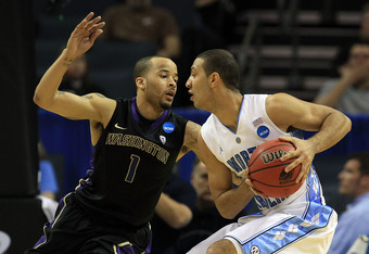 CHARLOTTE, NC - MARCH 20:  Kendall Marshall #5 of the North Carolina Tar Heels looks to pass against Venoy Overton #1 of the Washington Huskies during the third round of the 2011 NCAA men's basketball tournament at Time Warner Cable Arena on March 20, 201