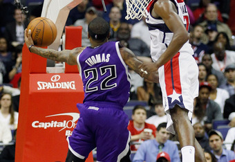 WASHINGTON, DC - FEBRUARY 22: Isaiah Thomas #22 of the Sacramento Kings puts up a shot in front of John Wall #2 of the Washington Wizards during the second half at Verizon Center on February 22, 2012 in Washington, DC. NOTE TO USER: User expressly acknowl