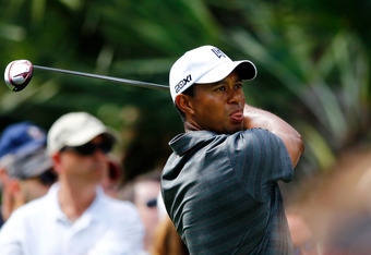 PONTE VEDRA BEACH, FL - MAY 10:  Tiger Woods of the United States hits his tee shot on the 15th hole during the first round of THE PLAYERS Championship held at THE PLAYERS Stadium course at TPC Sawgrass on May 10, 2012 in Ponte Vedra Beach, Florida.  (Pho