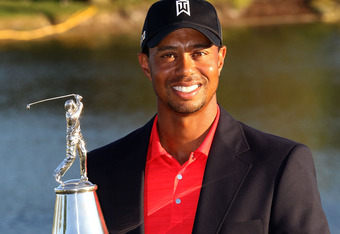ORLANDO, FL - MARCH 25:  Tiger Woods holds the trophy after winning the Arnold Palmer Invitational presented by MasterCard at the Bay Hill Club and Lodge on March 25, 2012 in Orlando, Florida.  (Photo by Sam Greenwood/Getty Images)