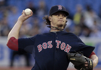 TORONTO, CANADA - JUNE 10:  Clay Buchholz #11 of the Boston Red Sox throws a pitch during MLB action against the Toronto Blue Jays at The Rogers Centre June 10, 2011 in Toronto, Ontario, Canada. (Photo by Abelimages/Getty Images)