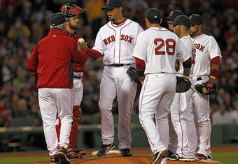 BOSTON, MA - MAY 10:  Bobby Valentine #25 of the Boston Red Sox removes Josh Beckett #19 in the third inning after Beckett had given up seven runs in three innings against the Cleveland Indians at Fenway Park May 10, 2012  in Boston, Massachusetts. (Photo