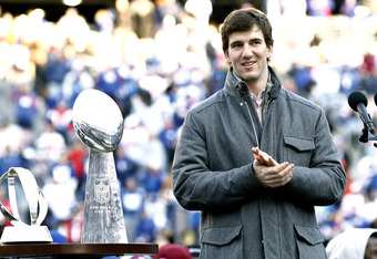 EAST RUTHERFORD, NJ - FEBRUARY 07:  Eli Manning #10 of the New York Giants speaks to fans at a rally to celebrate the New York Giants' Super Bowl victory at MetLife Stadium on February 7, 2012 in East Rutherford, New Jersey. The Giants defeated the New En