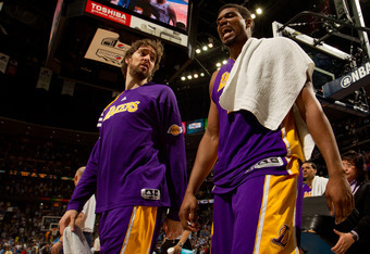 DENVER, CO - MAY 10:  Andrew Bynum #17 of the Los Angeles Lakers and Pau Gasol #16 react as they walk off the court after losing to the Denver Nuggets in Game Six of the Western Conference Quarterfinals in the 2012 NBA Playoffs at Pepsi Center on May 10,