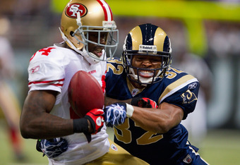 ST. LOUIS, MO - DECEMBER 26: Josh Morgan #84 of the San Francisco 49ers hauls in a pass against Bradley Fletcher #32 of the St. Louis Rams at the Edward Jones Dome on December 26, 2010 in St. Louis, Missouri. The Rams beat the 49ers 25-17. (Photo by Dilip