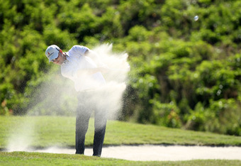 PONTE VEDRA BEACH, FL - MAY 11:  Zach Johnson of the United States hits his second shot on the sixth hole from a bunker during the second round of THE PLAYERS Championship held at THE PLAYERS Stadium course at TPC Sawgrass on May 11, 2012 in Ponte Vedra B